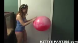 Cute Kitty in a tube top and tiny skirt